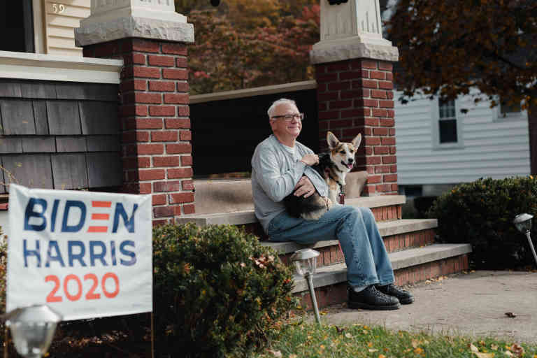 Michael Wolfkiel, 62, sits on his porch at his home in Nanticoke, PA., on Sunday, October 25, 2020. Wolfkiel was the first person in his neighborhood to put out Biden signs and has helped his neighbors put theirs up as well. He said he was never overt about his political beliefs but felt it was important to do so now. Hannah Yoon