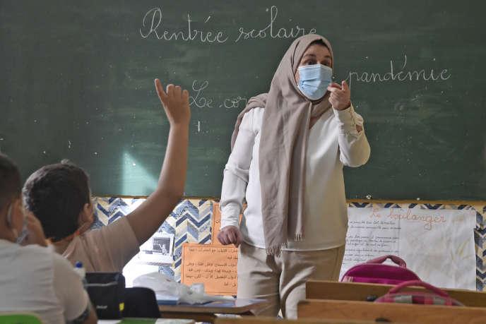Lors de la rentrée scolaire dans une classe d'une école d'Alger, le 21 octobre 2020.