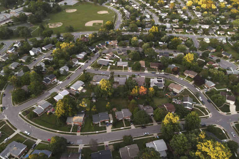 An aerial view shows a residential area near baseball fields at Ridgely Middle School, Wednesday, July 15, 2020, in Lutherville-Timonium, Md. (AP Photo/Julio Cortez)