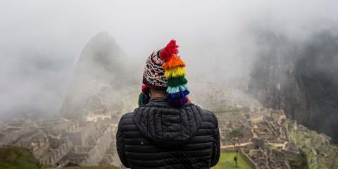 A tourist poses for a photo in front of the archaeological site of Machu Picchu, in Cusco, Peru on November 02, 2020, amid the new coronavirus pandemic. The Inca citadel of Machu Picchu, the crown jewel of Peru's tourist sites, reopened Sunday with an ancient ritual after a nearly eight-month lockdown due to the novel coronavirus pandemic. For safety reasons, however, only 675 tourists will be able to access the site per day, just 30 percent of the number of visitors pre-pandemic. / AFP / ERNESTO BENAVIDES
