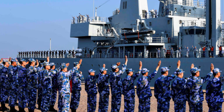 Soldiers of the Chinese People's Liberation Army (PLA) Navy take part in a ceremony as a replenishment ship sets sail to the Gulf of Aden and the waters off Somalia, from a naval port in Qingdao, Shandong province, China September 3, 2020. Picture taken September 3, 2020. China Daily via REUTERS  ATTENTION EDITORS - THIS IMAGE WAS PROVIDED BY A THIRD PARTY. CHINA OUT. - RC2AWI98UOJO