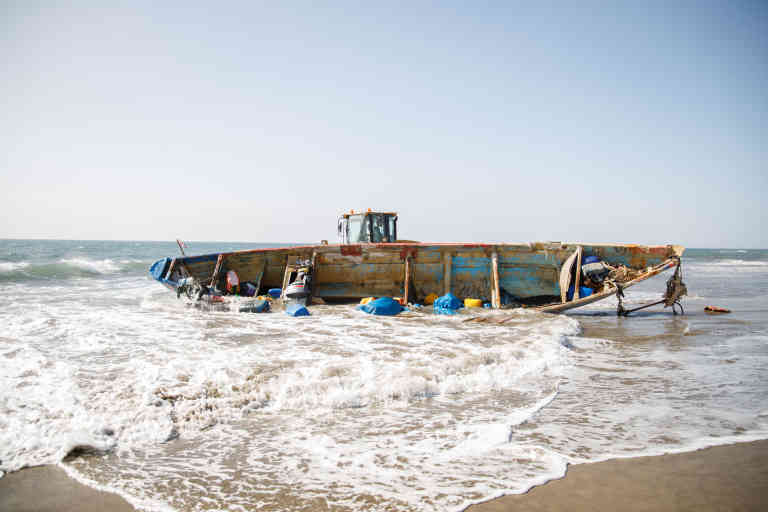 Mas Palomas beach, Gran Canaria. The police are guarding the boat in which 44 migrants of sub-Saharan origin have arrived at Mas Palomas beach, in Gran Canaria. This beach, one of the main tourist attractions on the island, has become a common arrival point for boats.