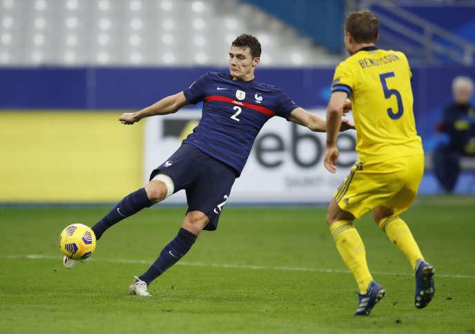 Une action du défenseur Benjamin Pavard, auteur d'un but contre la Suède, mardi17novembre au Stade de France.