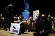 Des manifestants installés place de la République à Paris, mardi 24 novembre.