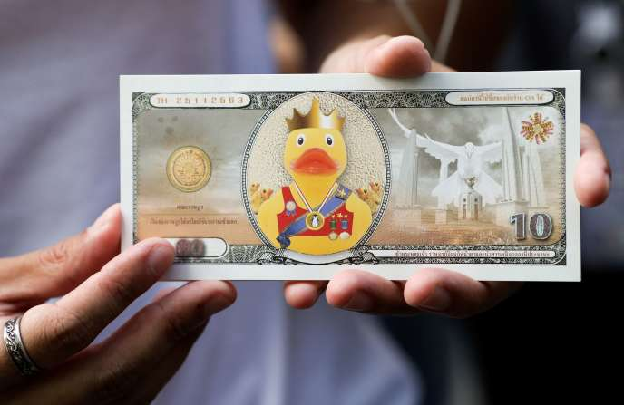 A fake banknote depicting a duck at a pro-democracy rally demanding that the King of Thailand return the royal assets to the people, in Bangkok, 25 November 2020.