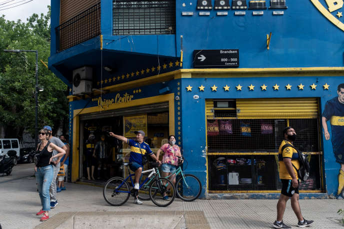 Fans and neighbors gather in front of the La Bombonea Stadium in Buenos Aires.