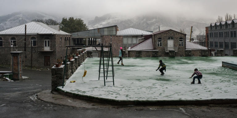 Goris, Armenia, 23 November 2020   Refugee children play with the first snow outside of the hotel in Goris, the last Armenian city before the border with Nagorno-Karabakh.   Olga Kravets/NOOR