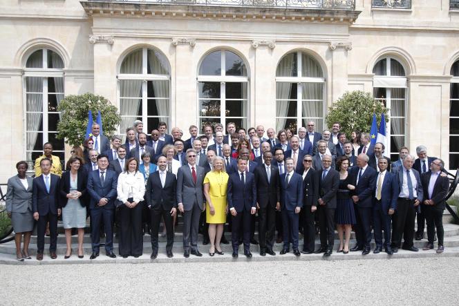Les dirigeants des entreprises technologiques et le président Emmanuel Macron, lors du sommet Tech for Good, en mai 2018, à l'Elysée, à Paris.