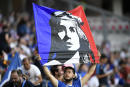 A French supporter holds a banner with a drawing of Marianne, the symbol of French republic ahead of the France 2019 Women's World Cup Group A football match between France and Norway, on June 12, 2019, at the Nice Stadium in Nice, southeastern France. (Photo by CHRISTOPHE SIMON / AFP)
