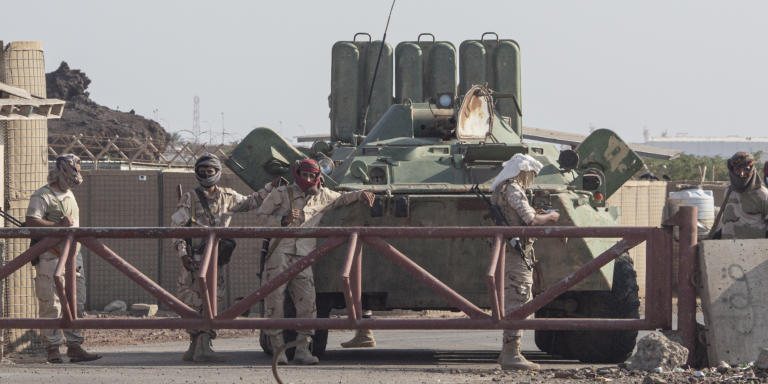Local militia members guard a checkpoint at the entrance to the Balhaf LNG facility and military base in Shabwa Province, Yemen, on November 13, 2020. [Sam Tarling / Sana'a Center / ]