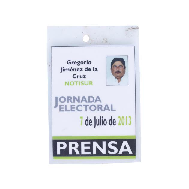 Son accréditation pour la couverture de la campagne présidentielle, en 2013.