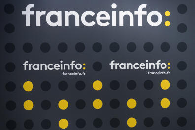 The new logo of Franceinfo is pictured on August 26, 2016 at the French public service radio broadcaster Radio France's headquarters at the Maison de la Radio in Paris. - Franceinfo, formerly a 24-hour news radio station operated by Radio France, will become as of September 1, 2016 integrated into a new triple media 24-hour platform comprising of a rolling news channel, a reworked news radio station and a news website operating under the same name, the same logo and airing some shared content provided by four public broadcasting groups : France Televisions, Radio France, France 24 and the INA for archival images. The new public news channel will be broadcast on channel 27 of TNT. (Photo by LIONEL BONAVENTURE / AFP)