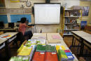 A teacher prepares the new school year on September 1, 2014 in a primary school of the ninth arrondissement of Paris, on the eve of the first day of the school year. AFP PHOTO / THOMAS SAMSON (Photo by THOMAS SAMSON / AFP)