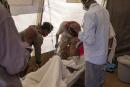 Nurses tend to an elderly man inside a clinic run by MSF (Doctors Without Borders) in the Umm Rakouba refugee camp in Qadarif, eastern Sudan, Monday, Dec. 14, 2020. (AP Photo/Nariman El-Mofty)
