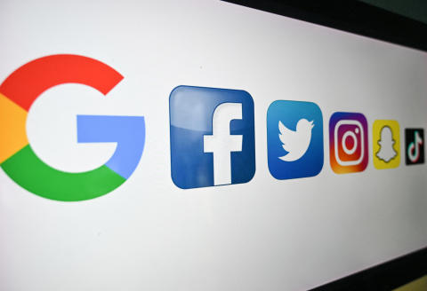 A photo taken on October 21, 2020 shows the logo of the multinational American Internet technology and services company, from left : Google, the American online social media and social networking service, Facebook, Twitter, Instragram, Snapchat, and Tik Tok on a computer screen in Lille. (Photo by DENIS CHARLET / AFP)