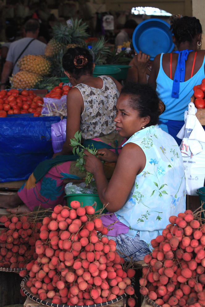 Lychee vendor on the Hell-Ville market, on the island of Nosy Be, in Madagascar, in 2013.