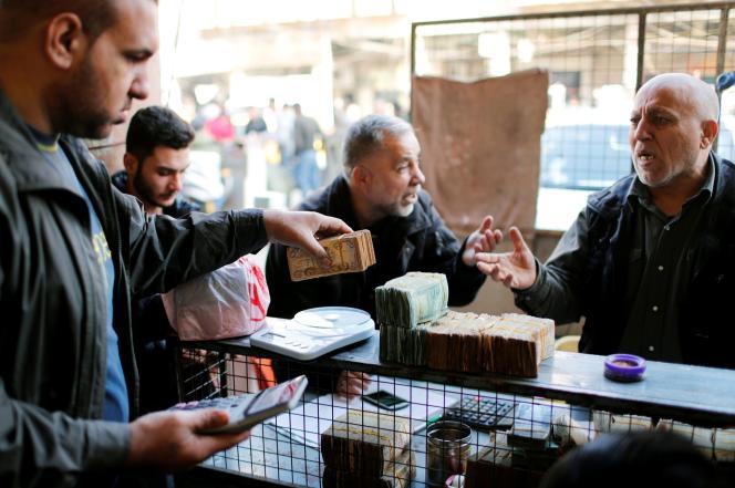 Bureau de change, à Bagdad, le 20 décembre.