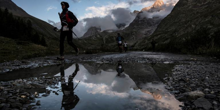 Ultra-trailers compete at sunrise on September 2, 2017 in Courmayeur, Italy, during the 15th edition of the Mount Blanc Ultra Trail (UTMB), a 170 km race around the Mont Blanc crossing France, Italy and Switzerland. - The 15th Ultra-Trail du Mont-Blanc (UTMB) is a mountain ultramarathon with numerous passages in high altitude (>2500m) and in difficult weather conditions (night, wind, cold, rain or snow). It takes place once a year in the Alps, across France, Italy and Switzerland. (Photo by JEFF PACHOUD / AFP)