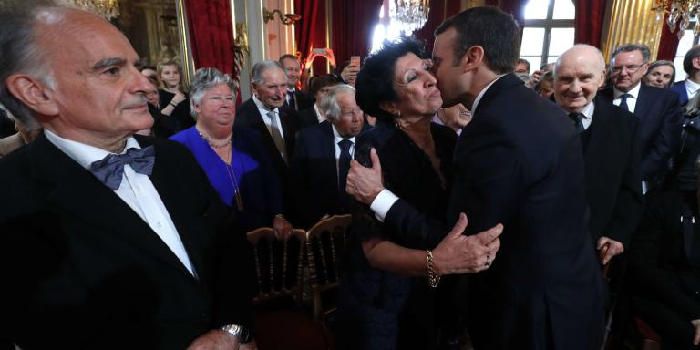 New French President Emmanuel Macron kisses his mother Francoise Nogues as his father Jean-Michel Macron, left, looks on during the handover ceremony, in Paris, Sunday, May 14, 2017. Macron was inaugurated Sunday as France's new president at the Elysee Palace in Paris, and immediately launched into his mission to shake up French politics, world economics and the European Union. (Philippe Wojazer, Pool via AP)/PAR190/17134456569126/POOL IMAGE/1705141446