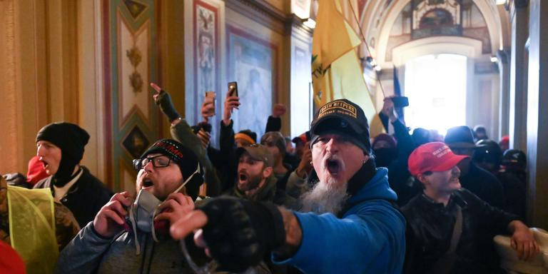 Supporters of US President Donald Trump protest inside the US Capitol on January 6, 2021, in Washington, DC. Demonstrators breeched security and entered the Capitol as Congress debated the a 2020 presidential election Electoral Vote Certification. / AFP / ROBERTO SCHMIDT