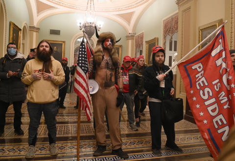 Supporters of US President Donald Trump, including member of the QAnon conspiracy group Jake A, aka Yellowstone Wolf (C), enter the US Capitol on January 6, 2021, in Washington, DC. - Demonstrators breeched security and entered the Capitol as Congress debated the a 2020 presidential election Electoral Vote Certification. (Photo by Saul LOEB / AFP)