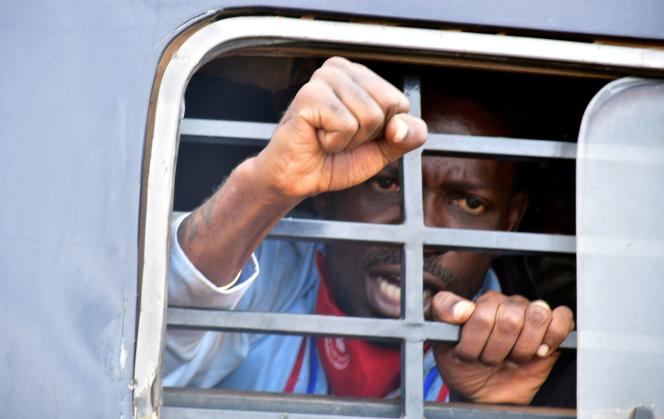 After his arrest, candidate Robert Kyagulanyi protests from inside a police van in Luuka district, eastern Uganda, November 18, 2020.