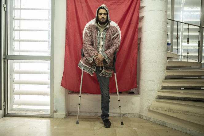 Wael Karrafi, 30 (here in Tunis, January 12), lost his leg during protests ten years ago.