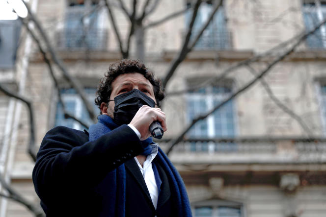 The lawyer for the Chouviat family, Arié Alimi, speaks during a white march in memory of Cédric Chouviat, in Paris on January 3.