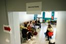 """School students sit in the waiting room after being tested at an operation center for a Covid-19 mass testing campaign at a High School in Montivillliers, northern France on December 15, 2020. In order to deploy the new """"Test, Alert, Protect"""" strategy, the health authorities wanted to be able to test all the new tools at the scale of territory by carrying out several massive testing campaigns. Four experiments, at the initiative of local authorities or ARS and with the support of the State, have thus been announced for the coming weeks: Le Havre, Charleville-Mezières, Roubaix, and Saint-Etienne. / AFP / Sameer Al-DOUMY"""
