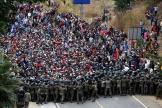 Des milliers de Honduriens se dirigeants vers les Etats-Unis se heurtent à aux soldats guatémaltèques à Vado Hondo, le 17 janvier 2021.