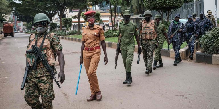 Security forces officers are seen during a joint patrol in a street ahead of Uganda's election results announcement in Kampala, Uganda, on January 16, 2021.  / AFP / Yasuyoshi Chiba