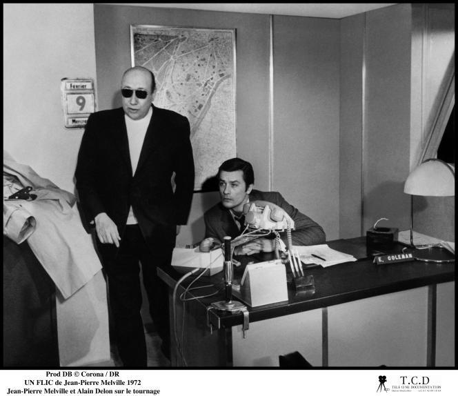 Jean-Pierre Melville et Alain Delon sur le tournage d'« Un flic» (1972).