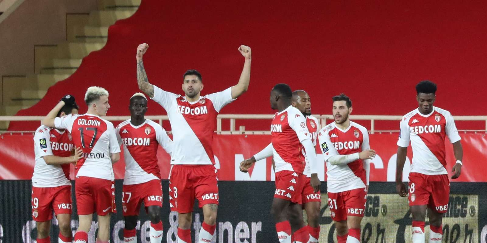 Monaco's French midfielder Aurelien Tchouameni (R) celebrates with teammates after scoring a goal during the French L1 football match Monaco and Marseille at