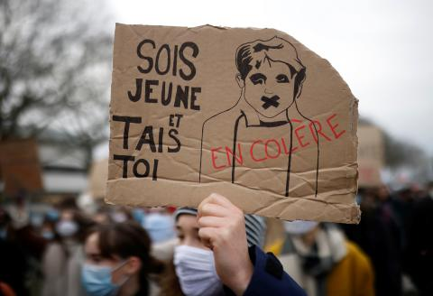 """French schoolteachers, university teachers and students demonstrate for better working and study conditions, employment and salary increases in Nantes as part of a day of mobilisation within France, during the coronavirus disease (COVID-19) outbreak, January 26, 2021. The slogan reads """"Angry. Be young and shut up"""". REUTERS/Stephane Mahe"""