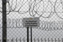 "FILE - In this file photo dated Monday, April 8, 2019, a sign reading: ""State Border"" is attached to a fence at Hungary's border with Serbia near the village Asotthalom, Hungary. The European Union's border control agency Frontex, said Wednesday Jan. 27, 2021, it is suspending operations in Hungary after the government in Budapest did not comply with a ruling by Europe's highest court on the rights of asylum-seekers. (AP Photo/Darko Vojinovic, FILE)"