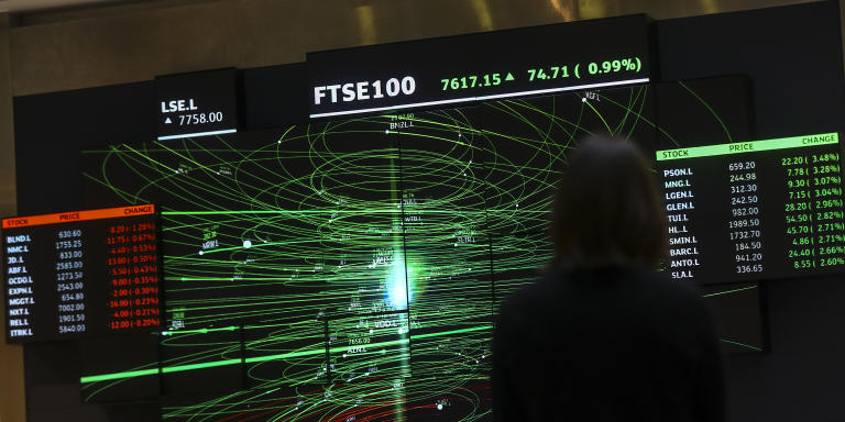 An employee views a FTSE share index board in the atrium of the London Stock Exchange Group Plc's offices in London, U.K., on Thursday, Jan. 2, 2020. Stocks started the year on the front foot, building on strong gains for many asset classes in 2019 as investors cheered the latest policy move by Chinas central bank to support its economy. Photographer: Simon Dawson/Bloomberg via Getty Images