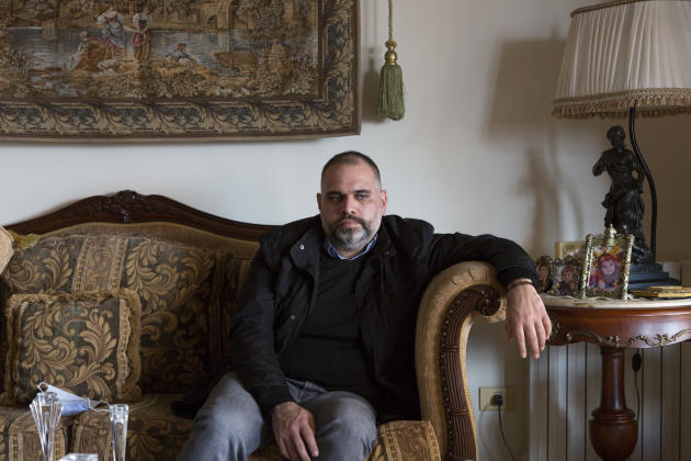 Walid Soufi, 37, a university professor and father of two, in his cousin's apartment in Tripoli, January 29, 2021.