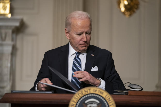 President Biden signs climate change decrees in the State Dining Room of the White House in Washington on Jan.27.