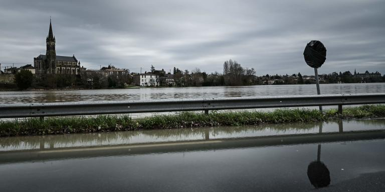 A flooded road is pictured near Cadillac, southwest of France, after the Garonne river overflowed following heavy rainfalls, on February 3, 2021.  / AFP / Philippe LOPEZ