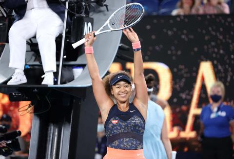 Japan's Naomi Osaka celebrates winning against Jennifer Brady of the US during their women's singles final match on day thirteen of the Australian Open tennis tournament in Melbourne on February 20, 2021. -- IMAGE RESTRICTED TO EDITORIAL USE - STRICTLY NO COMMERCIAL USE -- / AFP / David Gray / -- IMAGE RESTRICTED TO EDITORIAL USE - STRICTLY NO COMMERCIAL USE --