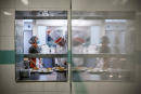 Students cook with professors, on June 11, 2020 in Saint Genis Laval, La Vidaude Hotel School's kitchen. - La Vidaude Hotel School aims at reintegrating youth and to avoid school drop-out, AFP reports on June 16, 2020. (Photo by JEFF PACHOUD / AFP)