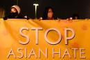 """People hold lights during a vigil organized by Nailing It For America for those who have died from Covid-19 and to """"Stop Asian Hate"""" on March 4, 2021 in Fountain Valley, California. Orange County community volunteers formed the message of """"Stop Asian Hate"""" with luminaries as reports of hate crimes against Asian Americans have increased since the beginning of the Covid-19 pandemic. / AFP / Patrick T. FALLON"""