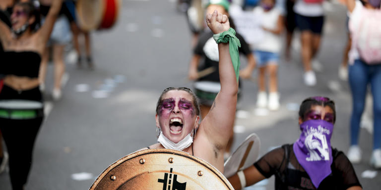 A woman shouts during a demonstration to mark International Women's Day in Buenos Aires, Argentina, Monday, March 8, 2021. (AP Photo/Natacha Pisarenko)