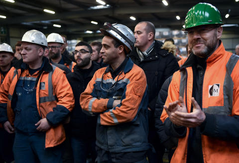 Workers of Ascoval steel plant in Saint-Saulve, near Valenciennes, northern France, react on December 19, 2018, inside the factory, as the Strasbourg Court of First Instance approved the resumption of the firm by the Franco-Belgian group Altifort. (Photo by FRANCOIS LO PRESTI / AFP)