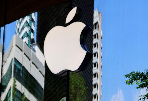 The Apple logo is seen on a window of the company's store in Bangkok on March 5, 2021. (Photo by Mladen ANTONOV / AFP)