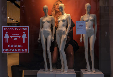 """An informative sticker on social distance guidelines on the shop window of a store, in Gibraltar, Thursday, March 4, 2021. Gibraltar, a densely populated narrow peninsula at the mouth of the Mediterranean Sea, is emerging from a two-month lockdown with the help of a successful vaccination rollout. The British overseas territory is currently on track to complete by the end of March the vaccination of both its residents over age 16 and its vast imported workforce. But the recent easing of restrictions, in what authorities have christened """"Operation Freedom,"""" leaves Gibraltar with the challenge of reopening to a globalized world with unequal access to coronavirus jabs. (AP Photo/Bernat Armangue)"""