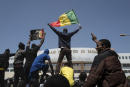 Demonstrators shout slogans during a protest against the arrest of opposition leader and former presidential candidate Ousmane Sonko near the Justice Palace of Dakar, Senegal, Monday, March 8, 2021. A Senegalese court cleared the way Monday for Sonko's release pending his rape trial in a case that already has sparked deadly protests and threatened to erode the country's reputation as one of West Africa's most stable democracies. (AP Photo/Sylvain Cherkaoui)