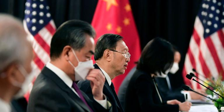 TOPSHOT - The Chinese delegation led by Yang Jiechi (C), director of the Central Foreign Affairs Commission Office and Wang Yi (2nd L), China's Foreign Minister, speak with their US counterparts at the opening session of US-China talks at the Captain Cook Hotel in Anchorage, Alaska on March 18, 2021. China's actions