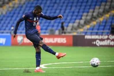 France's forward Ousmane Dembele shoots and scores a goal during the FIFA World Cup Qatar 2022 qualification Group D football match between Kazakhstan and France, at the Astana Arena, in Nur-Sultan, on March 28, 2021. / AFP / FRANCK FIFE