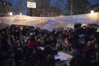"""Members of the self-called Feminist Committee gather on April 22, 2016 on the Place de la Republique in Paris, during the """"Nuit Debout"""" (Up All Night) movement against the French government's proposed labour reforms. - The Nuit Debout or """"Up All Night"""" protests began in March in opposition to the Socialist government's labour reforms seen as threatening workers' rights, but have since gathered a number of causes, from migrants' rights to anti-globalisation. (Photo by Elliott VERDIER / AFP)"""